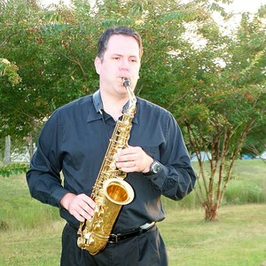 Tim_playing_sax_in_the_park_2013